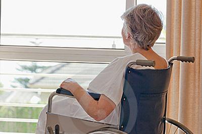 senior-woman-her-wheelchair-18255317